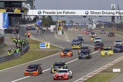 Start of the second group: #80 Live-Strip.com Racing BMW 330i: Fabian Plentz, Kristian Nägele, Dennis Nägele, Rudi Seher and #61 Mathol Racing Aston Martin Vantage V8: Matthias Holle, Rickard Nilsson, Frank Bierther