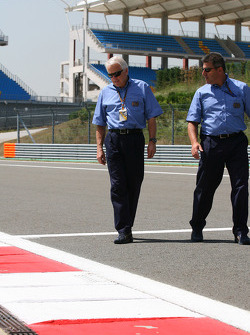 Charlie Whiting, FIA Safty delegate, Race director & offical starter inspects the circuit