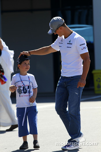 Michael Schumacher, Mercedes GP with a fan in the paddock