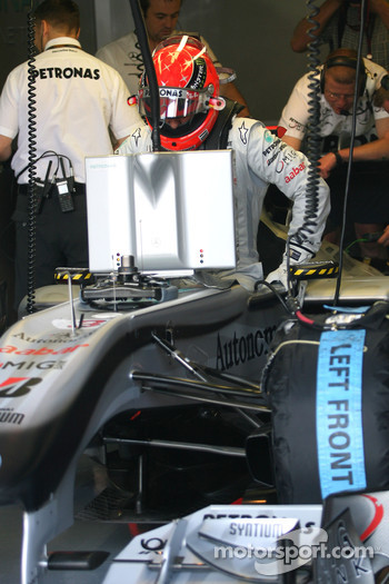 Michael Schumacher, Mercedes GP getting in the car