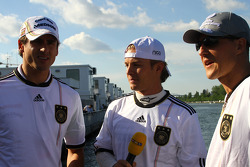 Adrian Sutil, Force India F1 Team, Nico Rosberg, Mercedes GP and Michael Schumacher, Mercedes GP supporting German football team