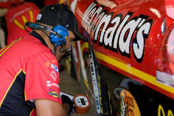 A crew member works on the No. 1 McDonald's Chevrolet
