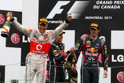 Jenson Button, McLaren Mercedes; Sebastian Vettel, Red Bull Racing; Mark Webber (AUS), Red Bull Racing