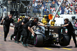 Lewis Hamilton, Mercedes AMG F1 W07 Hybrid is pushed back in the pits during qualifying
