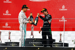 (L to R): Race winner Nico Rosberg, Mercedes AMG F1 celebrates with the champagne on the podium with third placed Sergio Perez, Sahara Force India F1