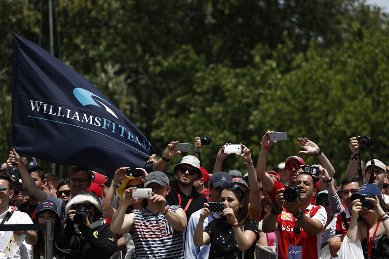 Fans fly the Williams F1 team flag