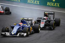 Felipe Nasr, Sauber C35 and Jenson Button, McLaren MP4-31 battle for position