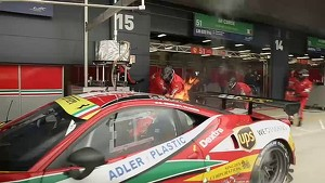 Ferrari on fire on the pitlane