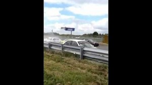 Car barrel rolls at start of Youngtimer race - outside view