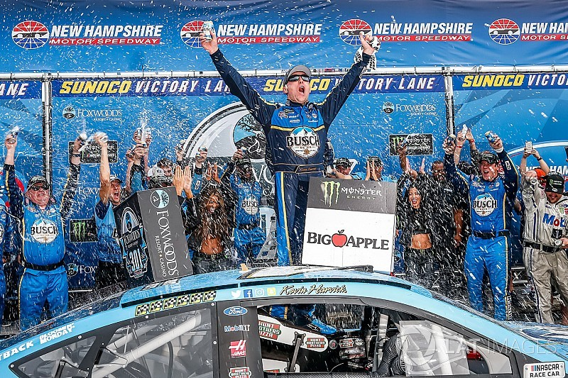 Harvick bumps Kyle Busch out of way to win New Hampshire