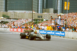 Ayrton Senna, Lotus 98T Renault, crosses the line for victory