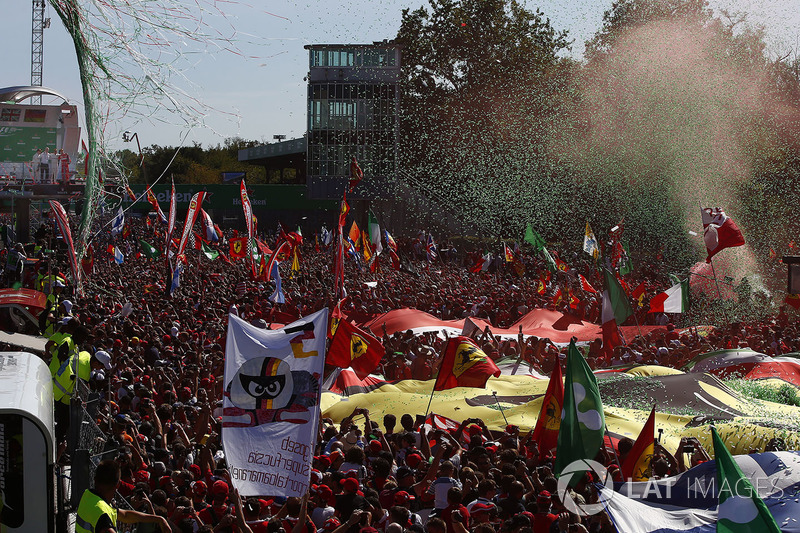 Confetti falls around the huge crowd of Ferrari fans gathered for the podium ceremony