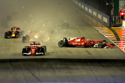 Sebastian Vettel, Ferrari SF70H leads at the start of the race and the cars of Kimi Raikkonen, Ferrari SF70H and Max Verstappen, Red Bull Racing RB13 crash after colliding