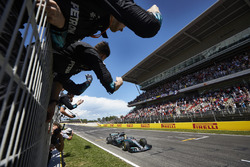 Lewis Hamilton, Mercedes AMG F1 W08, race winner, crosses the line to the delight of his team