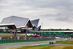 Clouds gather over the grid and the Wing pit building