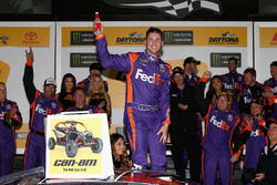 Denny Hamlin, Joe Gibbs Racing Toyota, celebrates in Victory Lane after winning the Monster Energy NASCAR Cup Series Can-Am Duel 2