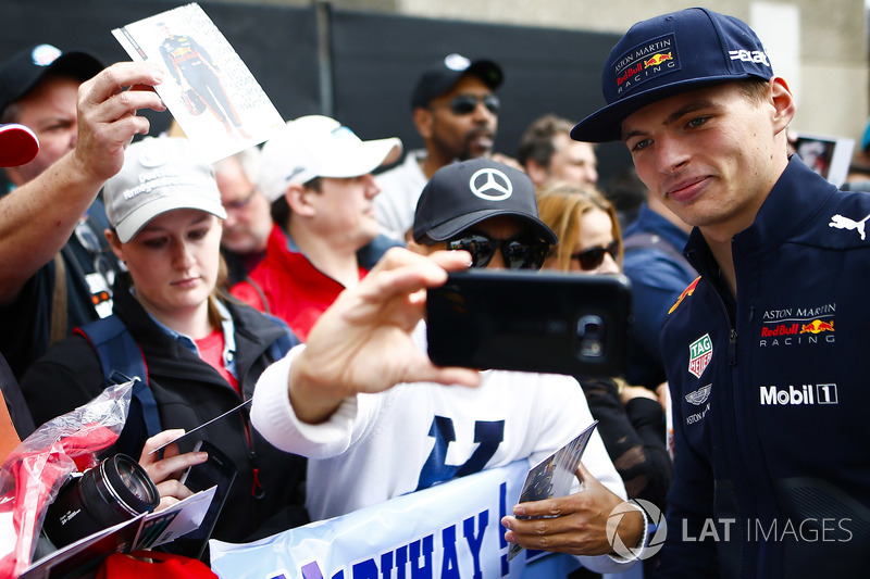 Max Verstappen, Red Bull Racing, poses for a picture with fans