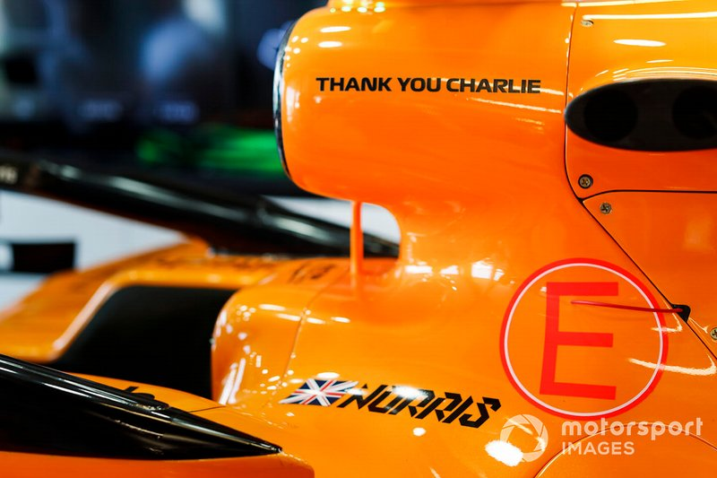 Car of Lando Norris, McLaren MCL34 in the garage with a thank you graphic in memory of Charlie Whiting