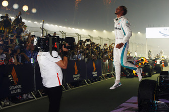 Lewis Hamilton, Mercedes AMG F1 W09 EQ Power+, jumps from his car as he celebrates in Parc Ferme after winning the race