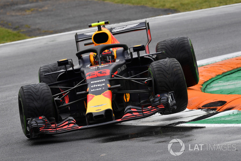 Max Verstappen, Red Bull Racing RB14 jumps over the kerb
