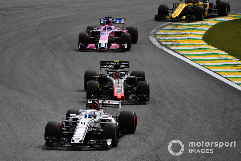 Marcus Ericsson, Sauber C37 leads Kevin Magnussen, Haas F1 Team VF-18 Kevin Magnussen, Haas F1 Team VF-18 and Sergio Perez, Racing Point Force India VJM11