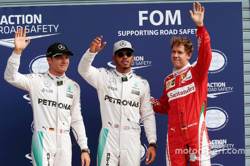 Qualifying top three in parc ferme (L to R): second place Nico Rosberg, Mercedes AMG F1; Pole positi