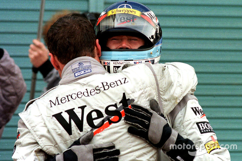 David Coulthard, McLaren hugs team mate and new World Champion Mika Hakkinen, McLaren