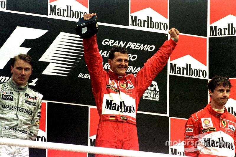 Podium: Race winner Michael Schumacher, Ferrari; second place Mika Hakkinen, McLaren; third place Ed
