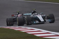 Valtteri Bottas, Mercedes AMG F1 W08, leads Kevin Magnussen, Haas F1 Team VF-17