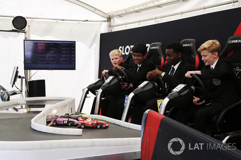 Schoolchildren enjoy a racing game