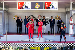 Race winner Sebastian Vettel, Ferrari, Second place Third place Kimi Raikkonen, Ferrari Daniel Ricciardo, Red Bull Racing, on the podium