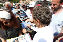 Alain Prost signs autographs for the fans