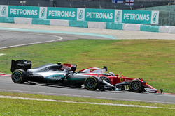 Nico Rosberg, Mercedes AMG F1 W07 Hybrid and Sebastian Vettel, Ferrari SF16-H at the start of the race following their collision