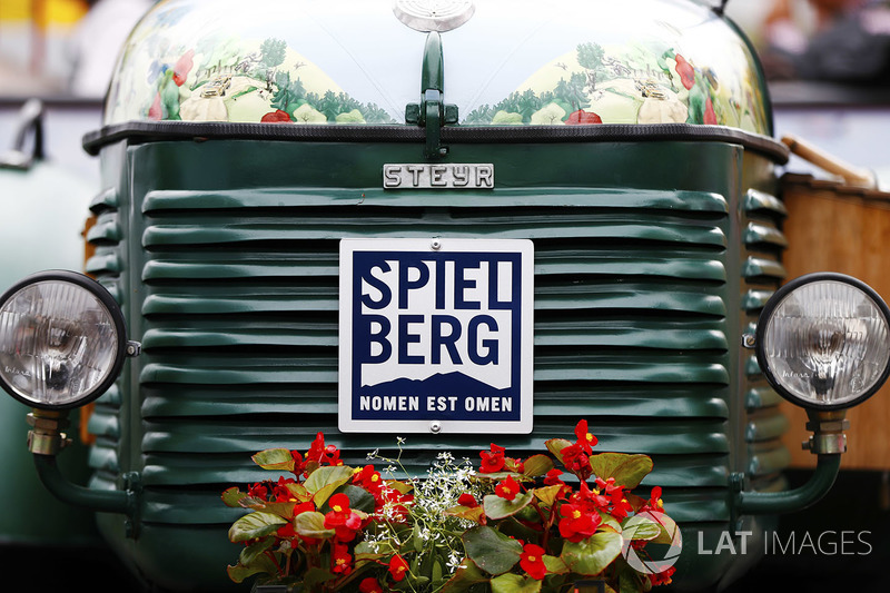 A tractor decked in flowers in the Red Bull Ring paddock