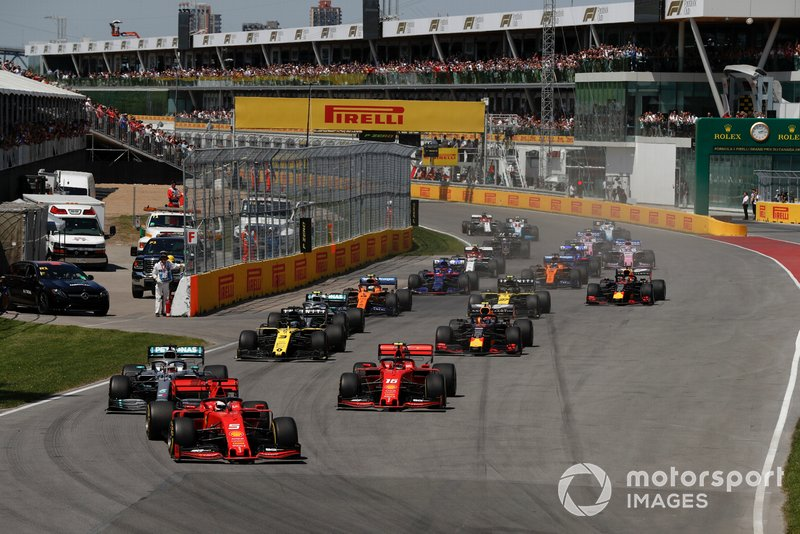 Sebastian Vettel, Ferrari SF90, leads Lewis Hamilton, Mercedes AMG F1 W10, Charles Leclerc, Ferrari SF90, Daniel Ricciardo, Renault R.S.19, Pierre Gasly, Red Bull Racing RB15, and the rest of the field at the start