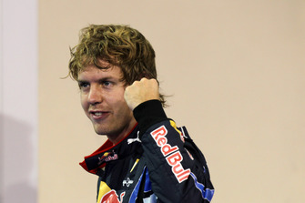 Sebastian Vettel, Red Bull Racing RB6 celebrates claiming pole position