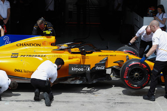 Stoffel Vandoorne, McLaren, returns to his pit garage after failing to progress from the first part of qualifying.