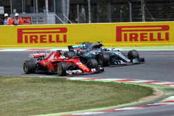 Sebastian Vettel, Ferrari SF70H and Valtteri Bottas, Mercedes-Benz F1 W08  battle for position