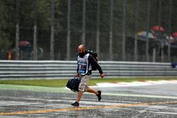 Cameraman on track in the rain