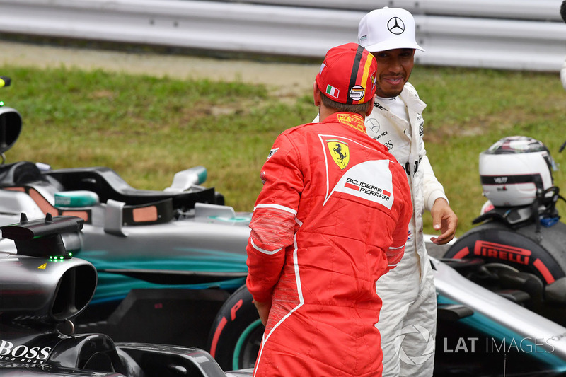 Sebastian Vettel, Ferrari and Lewis Hamilton, Mercedes AMG F1 in parc ferme
