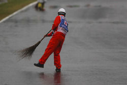 Marshal sweeps rain water off track