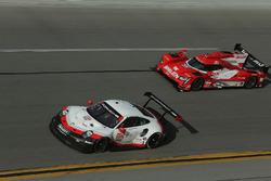#912 Porsche Team North America Porsche 911 RSR: Gianmaria Bruni, Laurens Vanthoor, Earl Bamber, #31 Action Express Racing Cadillac DPi: Eric Curran, Mike Conway, Stuart Middleton