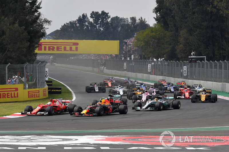Max Verstappen, Red Bull Racing RB13 and Sebastian Vettel, Ferrari SF70H battle at the start of the