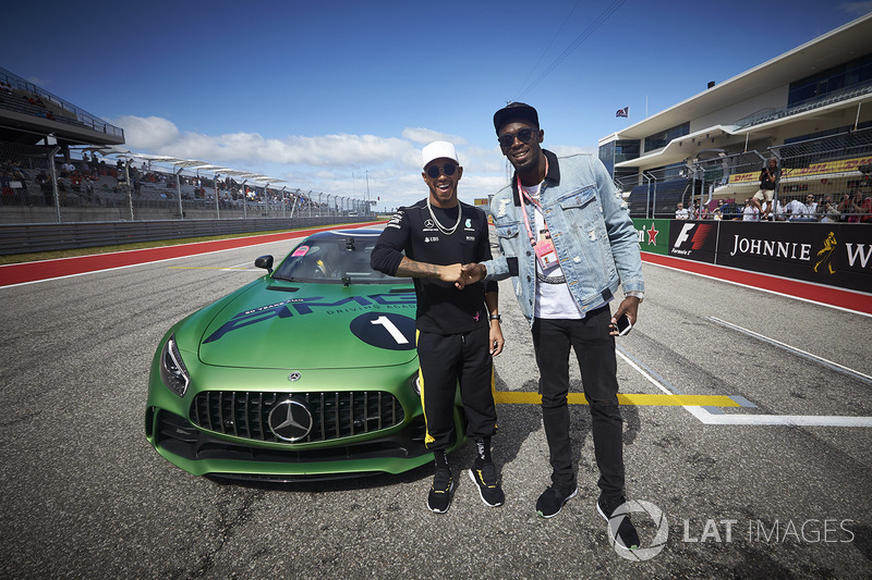 Usain Bolt is taken for a drive by Lewis Hamilton, Mercedes AMG F1