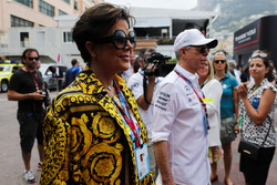 Reality television personality Kris Jenner and Tommy Hilfiger in the paddock