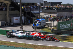 Sebastian Vettel, Ferrari SF70H and Valtteri Bottas, Mercedes-Benz F1 W08 battle for the lead at th
