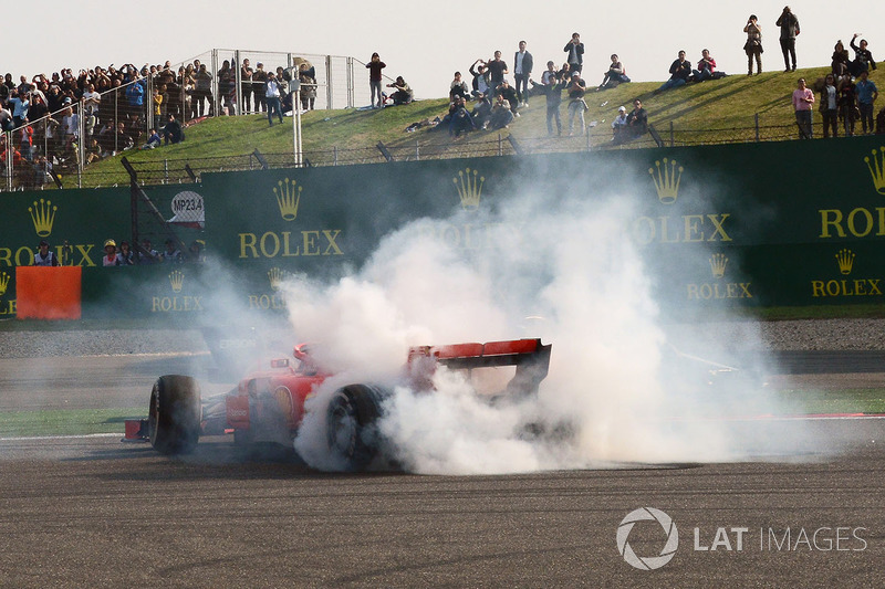 Sebastian Vettel, Ferrari SF71H spins after clashing with Max Verstappen, Red Bull Racing RB14