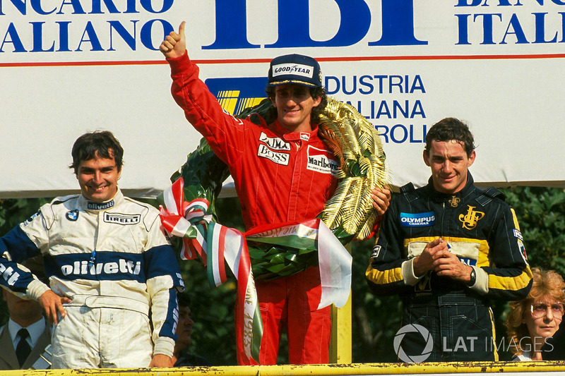 Podium: race winner Alain Prost, McLaren, second place Nelson Piquet, Brabham, third place Ayrton Senna, Lotus