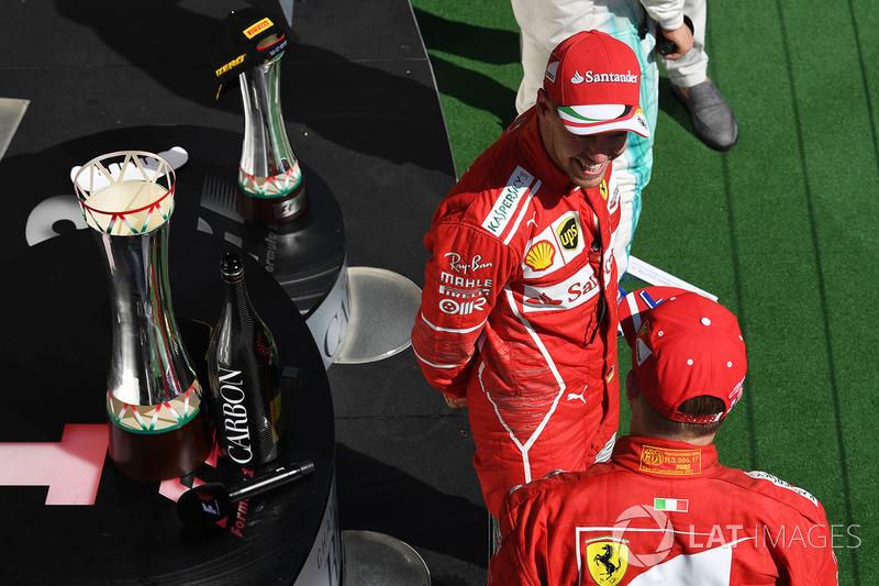 Подіум: переможець Себастьян Феттель, Кімі Райкконен, Ferrari