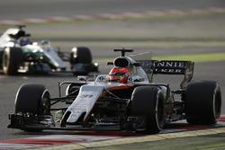 Esteban Ocon, Force India VJM10, leads Valtteri Bottas, Mercedes AMG F1 W08